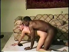 White girl in lingerie and high heels rides big black cock in retro porn