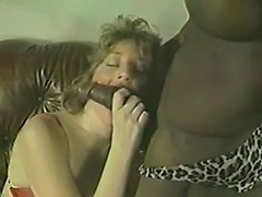 A muscular black guy gets his cock sucked by a married girl in vintage porn