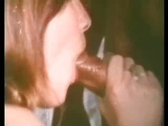 Big black dick slides into the eager mouth of this vintage cocksucker